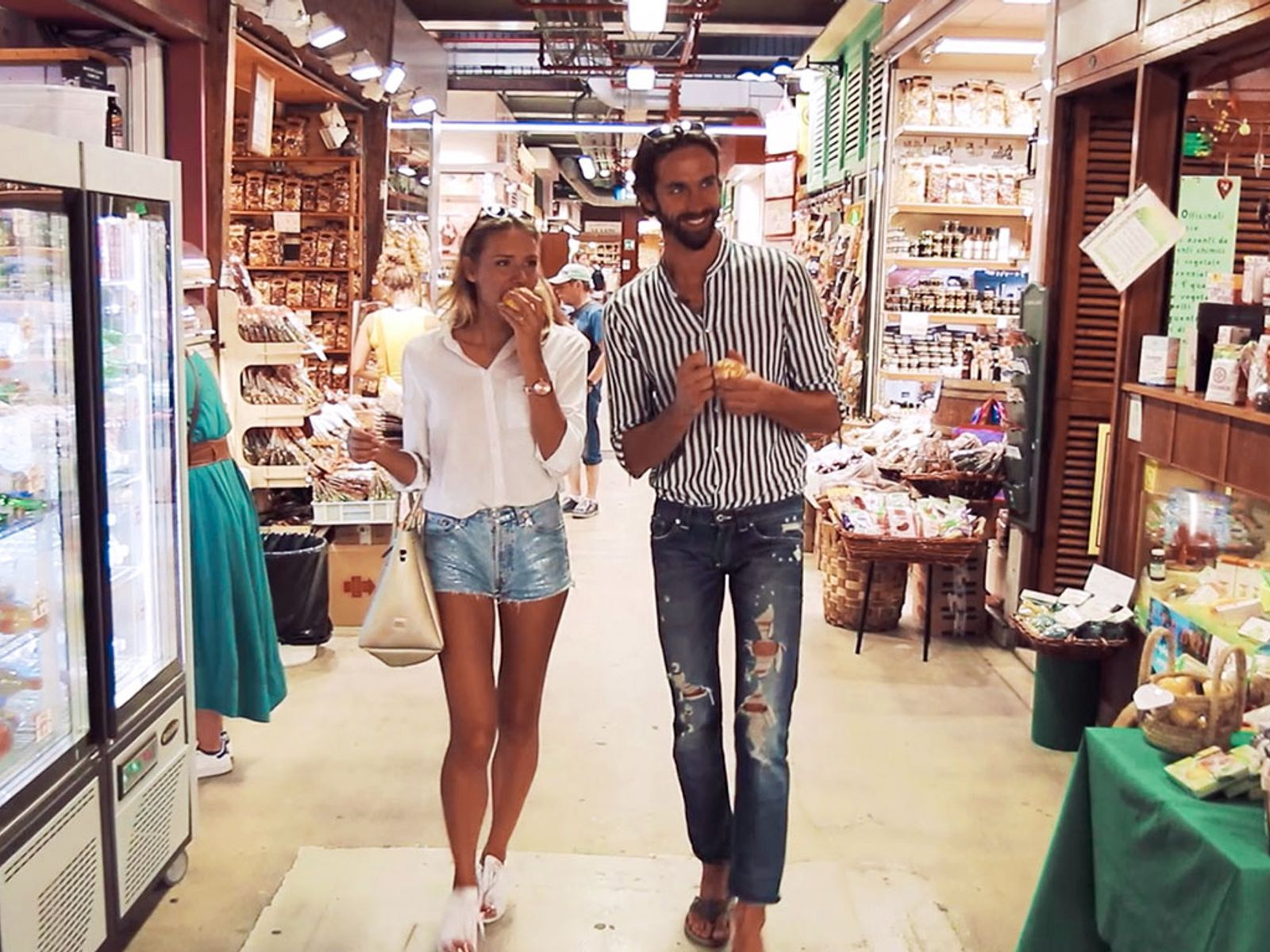 Couple Browsing Grocery Store for Online Italian cookling class